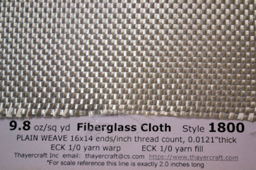 Close up of style 1800, 9.8 oz/sq yd fiberglass cloth with construction data
