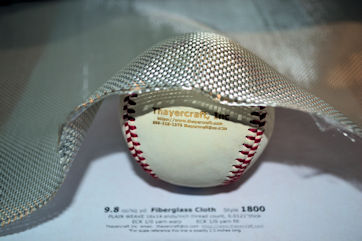 Style 1800 fiberglass cloth shaped around baseball